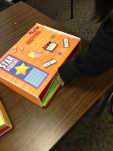 This box can be placed inside a desk to support a student that needs stimulation while seated in class.