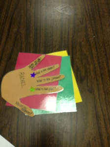Cutout of hand used as writing prompt. Colored cards to place on desk to indicate student mood.