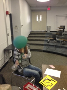 Therapy game for gross motor control made from a balloon tied between two water bottles. Very quiet game!