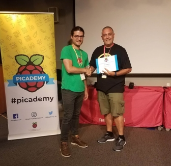 Mike accepting Picademy graduation certificate from Andrew Collins, Raspberry Pi Foundation